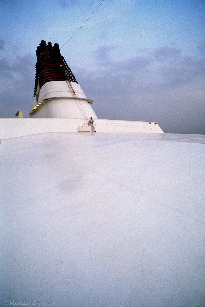 Young woman alone on the ship upper deck