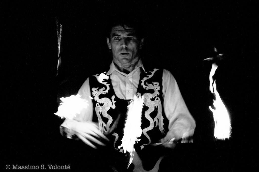 Travel light: Fire games - A juggler with sticks of fire