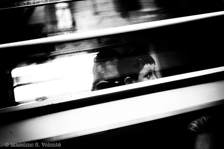 First God - Child looking through a train window