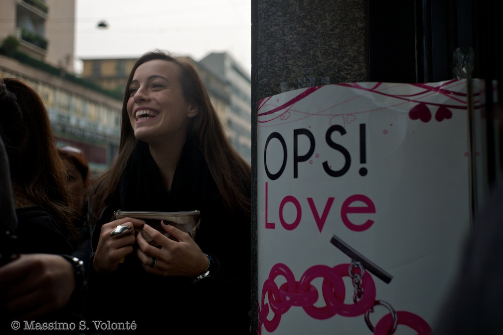 City Sickness 155 - A passing by girl near an adverting billborad