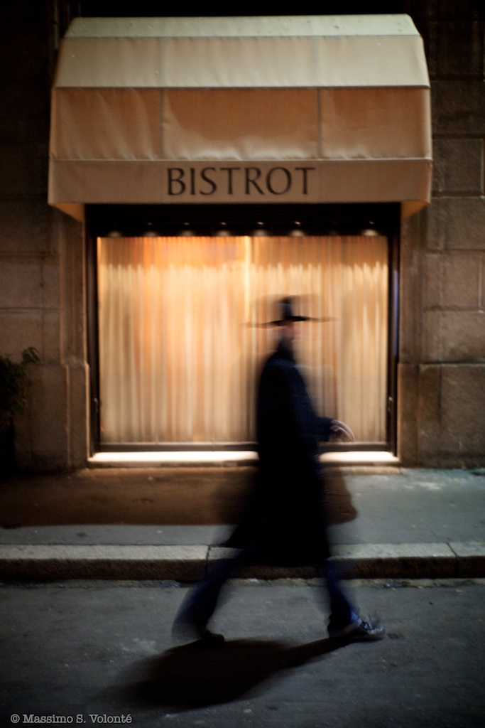 Only - Man passing by a bistrot window