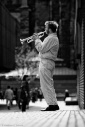 Travel light: What a wonderful life - Man playing trumpet on the street