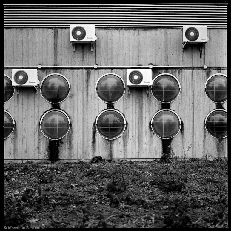 City sickness 192 - Industrial building facade with air cond motors and sphere like windows