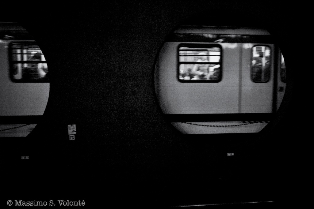 Symptom of the universe - Underground train seen through circular aperture in a station