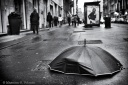 A broken umbrella on the sidewalk of the city