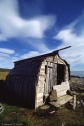 Postcard 58 - Wrecked boat shed
