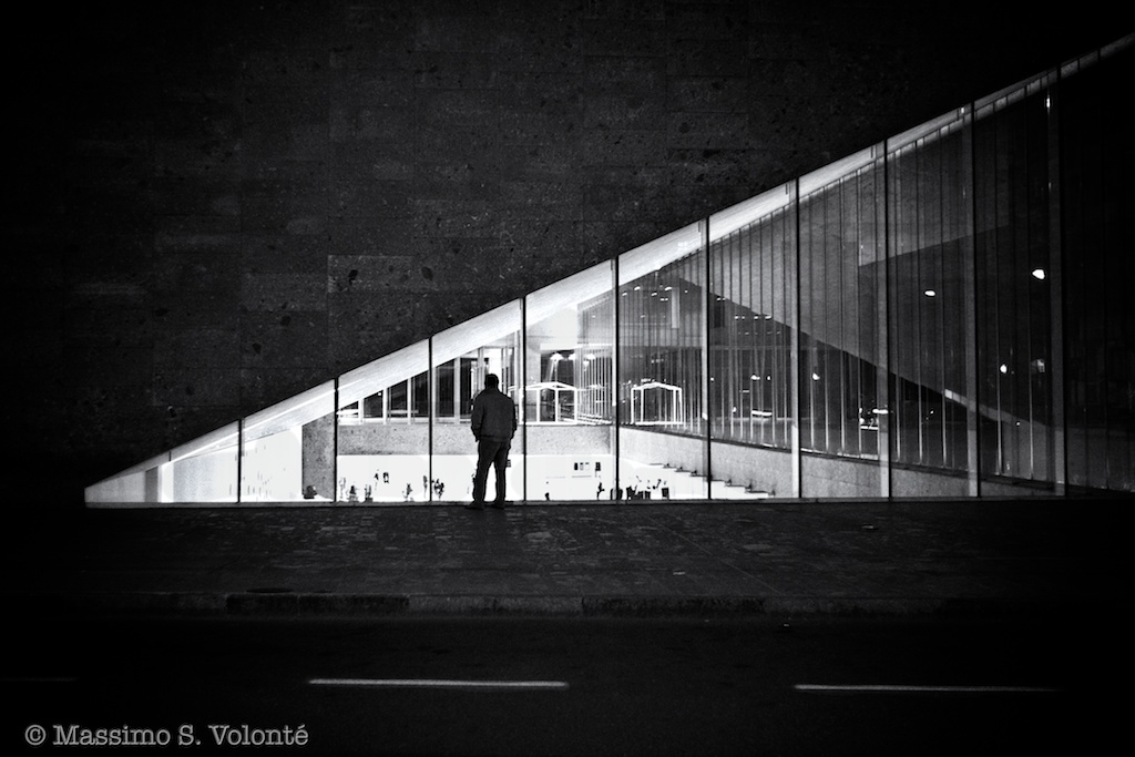 Man in front of a big window wall