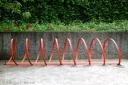 Red bicycles parking rail