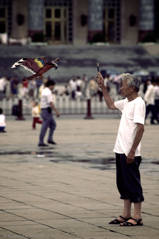 Man playing with his kite in Tienanmen
