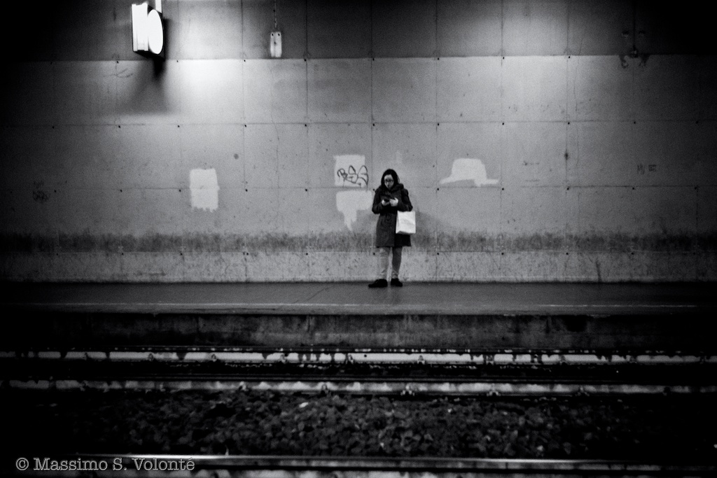 A commuter is waiting for the  next train