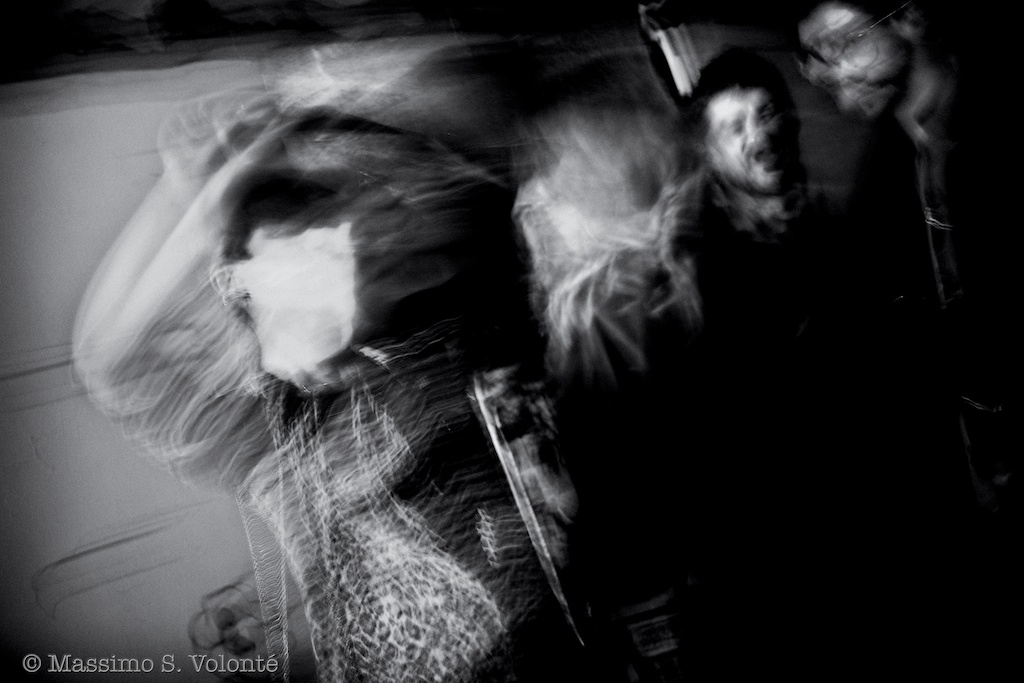 Blurred figures  dancing in a club