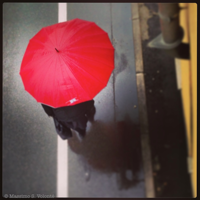 Open red umbrella from above