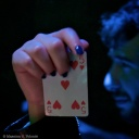 Hand holding a card...