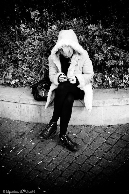 Young woman alone with her mobile...