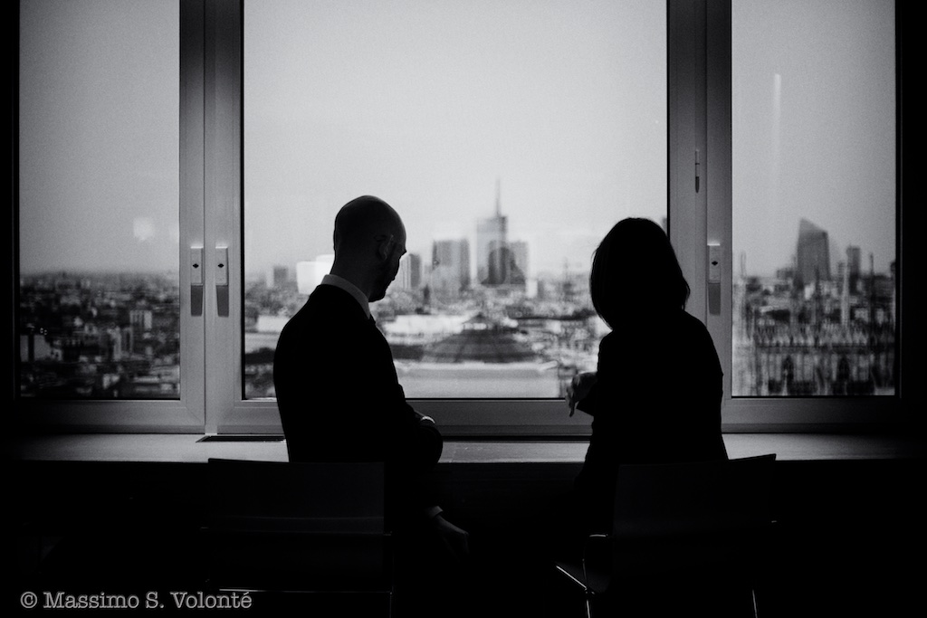 volonte photogrpher milano - a couple in front of a window over the city