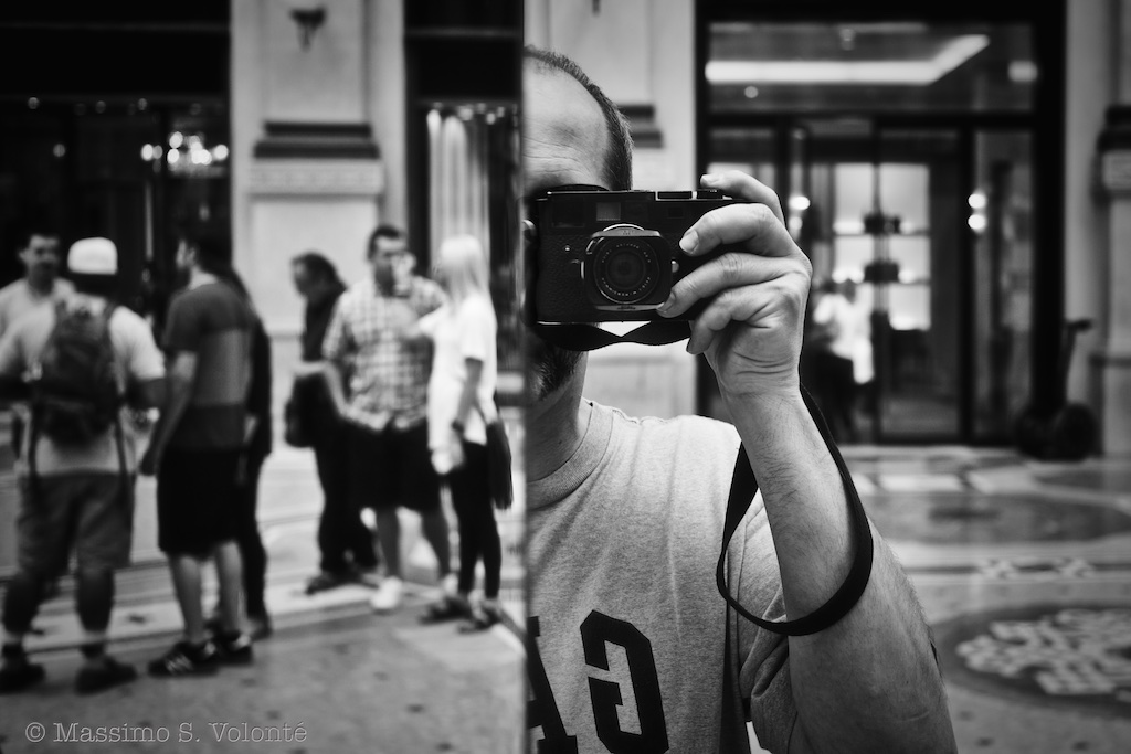 volonte photographer milano - self-portrait with camera in a mirror in the city
