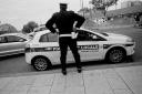 volonte fotografo milano - policeman overlooking the city traffic...