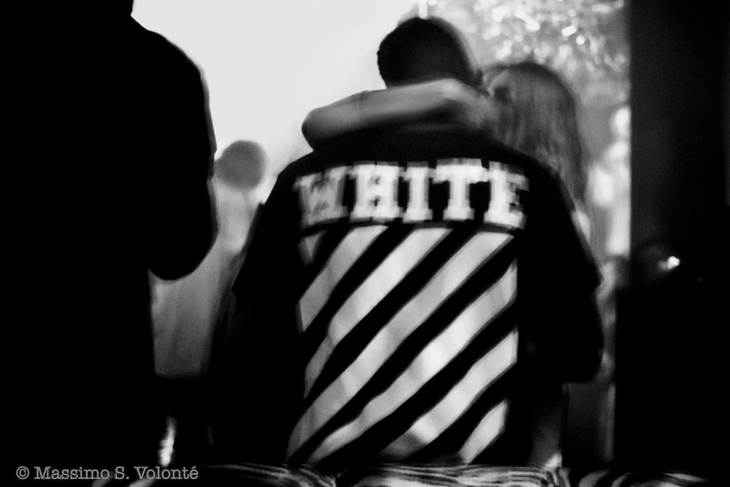 volonte photographer milano - white stripes on the back of a young man in the club