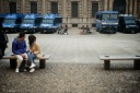 Police vehicles in a city square and tourists, fotografo milano