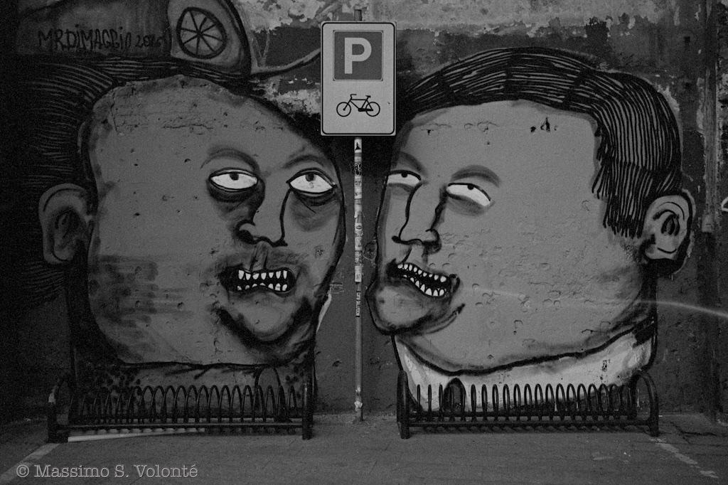 Big graffiti of two heads, black and white, volonte fotografo milano