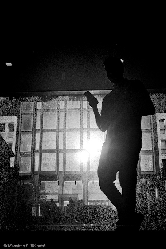 Silhouette of a man and his mobile, black and white, Volonte fotografo MIlano
